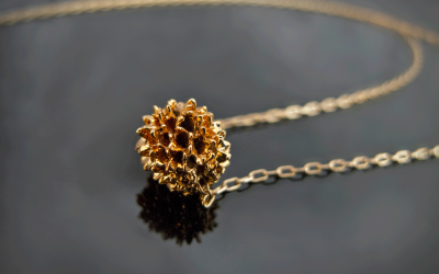 mini valencian seed plated with 24K Gold.