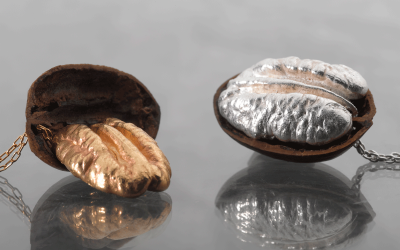 two Pecans plated in 24k gold and pure silver 925.